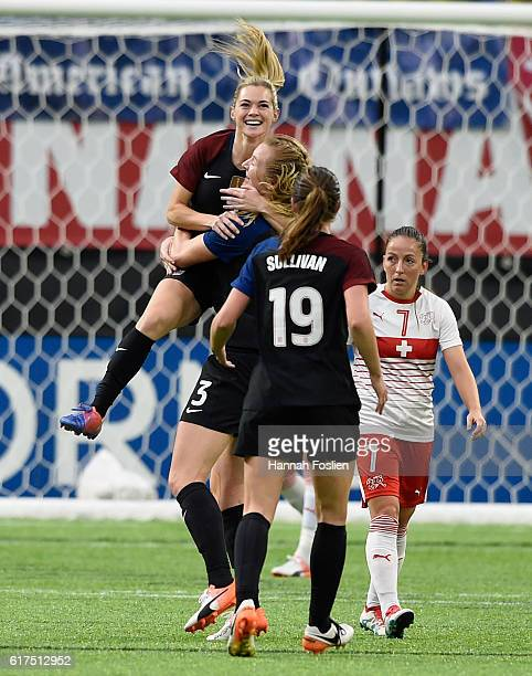 Samantha Mewis and Andi Sullivan of United States congratulate teammate Kealia Ohai on her first goal with the national team as Martina Moser of...