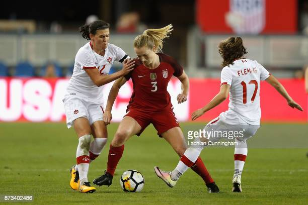 Samantha Mewis of the United States competes for the ball against Christine Sinclair and Jessie Fleming of Canada during a friendly match at Avaya...