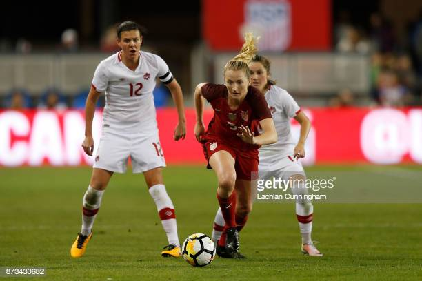 Samantha Mewis of the United States evades Christine Sinclair and Jessie Fleming of Canada during a friendly match at Avaya Stadium on November 12...