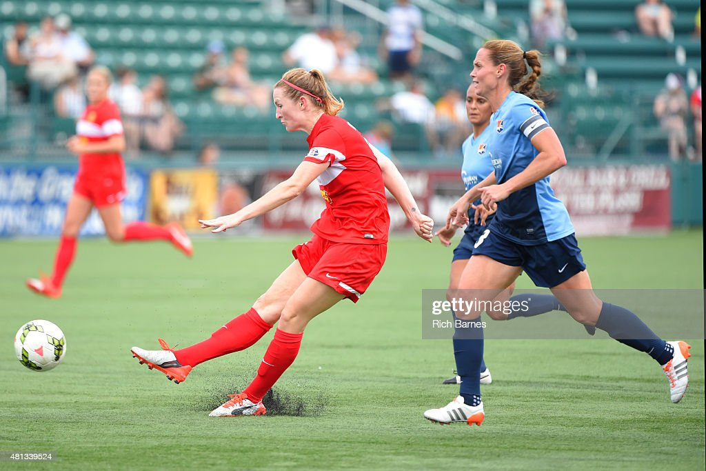 Samantha Mewis #5 of Western New York Flash takes a shot in front of Christie Rampone #3 of Sky Blue FC during the second half at Sahlen's Stadium on July 19, 2015 in Rochester, New York.