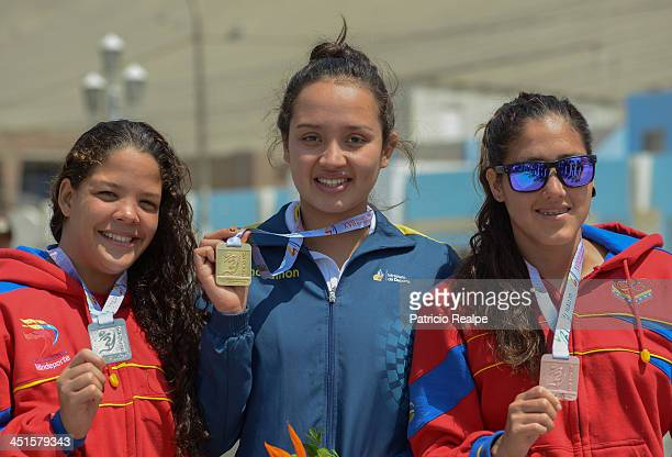 Samantha of Ecuador Malissabeth Navarro of Venezuela and Paola Perez of Venezuela of Venezuela poses after compete in Open Water Swimming 10 km as...