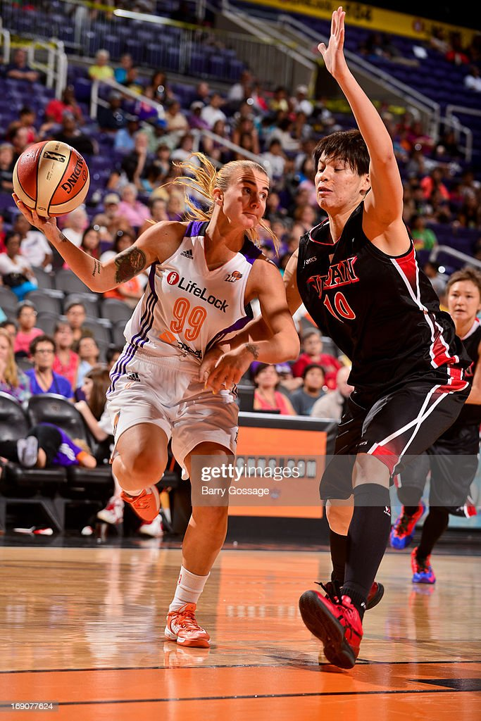 Samantha Prahalis #99 of the Phoenix Mercury drives against Ramu Tokashiki #10 of the Japanese National Team during a WNBA preseason game on May 19, 2013 at U.S. Airways Center in Phoenix, Arizona.