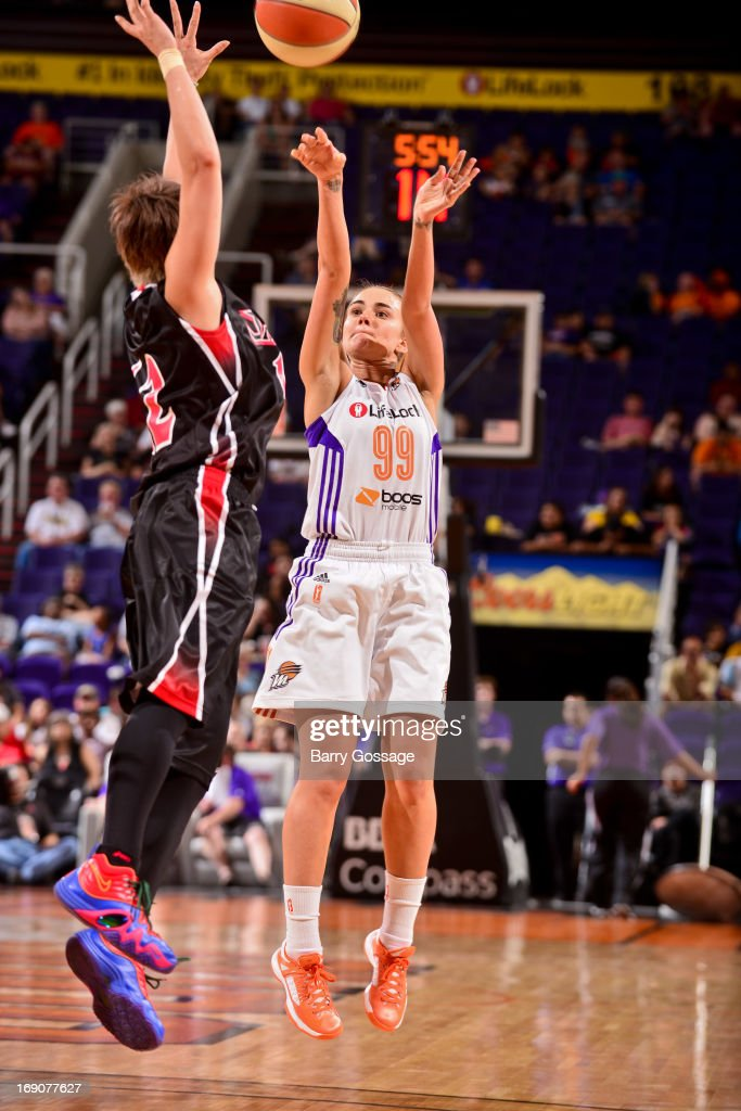 Samantha Prahalis #99 of the Phoenix Mercury shoots a three-pointer against Asami Yoshida #12 of the Japanese National Team during a WNBA preseason game on May 19, 2013 at U.S. Airways Center in Phoenix, Arizona.