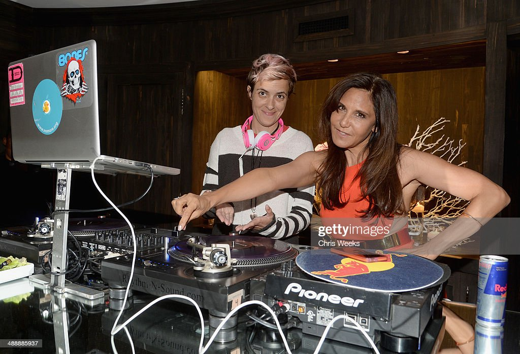DJ Samantha Ronson (L) and owner/designer of Chrome Hearts Laurie Lynn Stark spin at Chrome Hearts & Kate Hudson Host Garden Party To Celebrate Collaboration at Chrome Hearts on May 8, 2014 in Los Angeles, California.