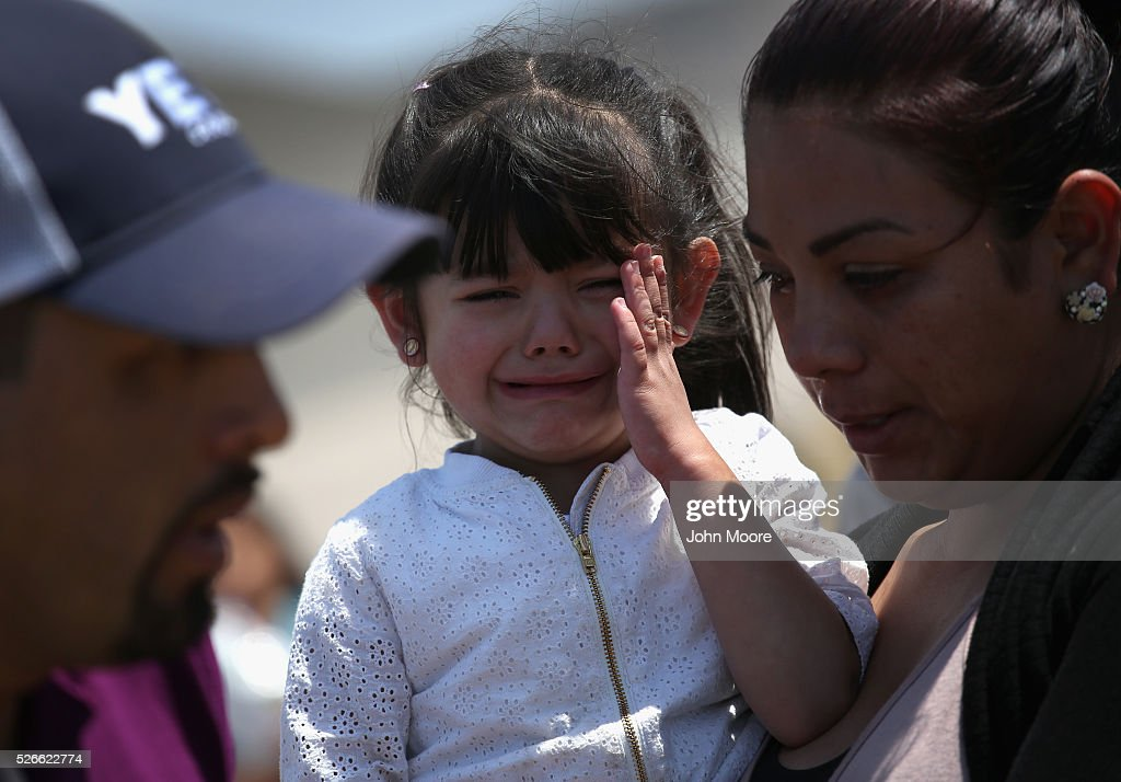 Samantha Simental, 3, cries after meeting family members from Mexico during an 'Opening the Door of Hope' event on April 30, 2016 in San Diego, California. Five families, with some members living in Mexico and others in the United States, were permitted to meet and embrace for three minutes each at a door in the fence, which the U.S. Border Patrol opened to celebrate Mexican Children's Day. It was only the third time the fence, which separates San Diego from Tijuana, had been opened for families to briefly reunite. The event was planned by the immigrant advocacy group Border Angels.