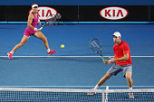 Samantha Stosur and John Peers of Australia play in their Round 1 mixed doubles match against Arina Rodionova and Matt Reid of Australia during day...