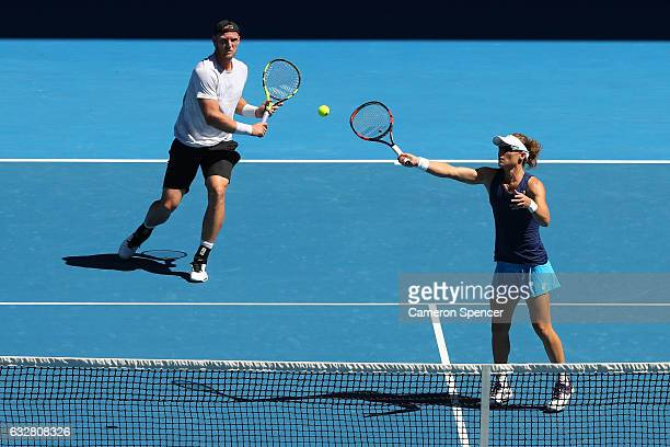 Samantha Stosur and Sam Groth of Australia compete against Sania Mirza of India and Ivan Dodig of Croatia in their mixed doubles semifinal match on...