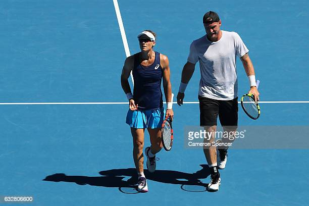 Samantha Stosur and Sam Groth of Australia talk tactics against Sania Mirza of India and Ivan Dodig of Croatia in their mixed doubles semifinal match...