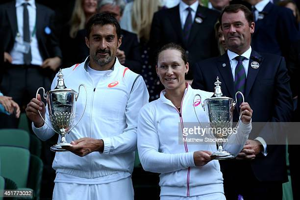 Samantha Stosur of Australia and Nenad Zimonjic of Serbia celebrate with the trophy after winning the Mixed Doubles final against Max Mirnyi of...