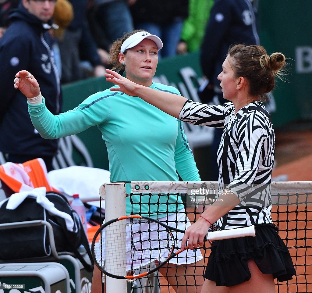 Samantha Stosur (L) of Australia and Simona Halep (R) of Romania gesture during the women's single fourth round match at the French Open tennis tournament at Roland Garros Stadium in Paris, France on May 30, 2016.