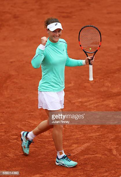 Samantha Stosur of Australia celebrates victory during the Ladies Singles fourth round match against Simona Halep of Romania on day ten of the 2016...