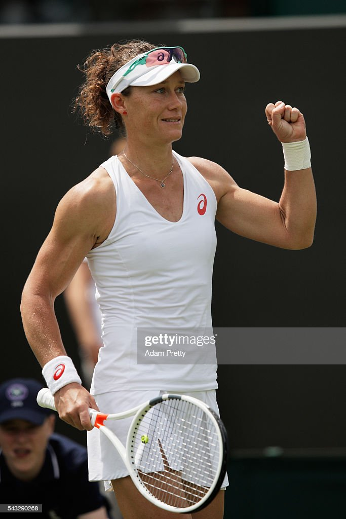 <a gi-track='captionPersonalityLinkClicked' href=/galleries/search?phrase=Samantha+Stosur&family=editorial&specificpeople=194778 ng-click='$event.stopPropagation()'>Samantha Stosur</a> of Australia celebrates victory during the Ladies Singles first round match against Magda Linette of Poland on day one of the Wimbledon Lawn Tennis Championships at the All England Lawn Tennis and Croquet Club on June 27th, 2016 in London, England.