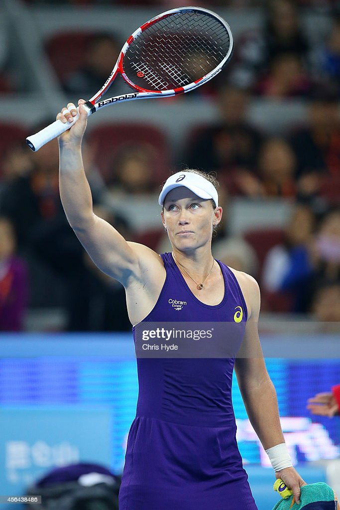 Samantha Stosur of Australia celebrates winning her match against Caroline Wozniacki of Denmark during day five of of the China Open at the National Tennis Center on October 1, 2014 in Beijing, China.