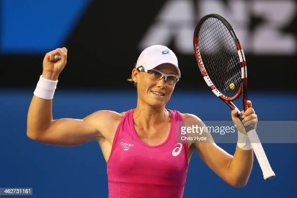 Samantha Stosur of Australia celebrates winning her second round match against Tsvetana Pironkova of Bulgaria during day three of the 2014 Australian...