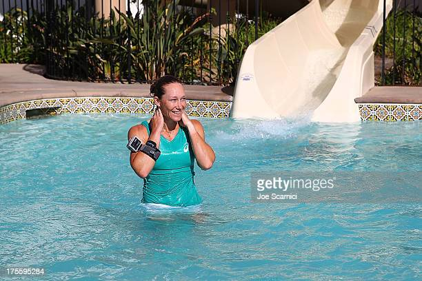 Samantha Stosur of Australia goes down the ceremonial water slide after winning the final match against Victoria Azarenka of Bulgaria 62 63 at the...