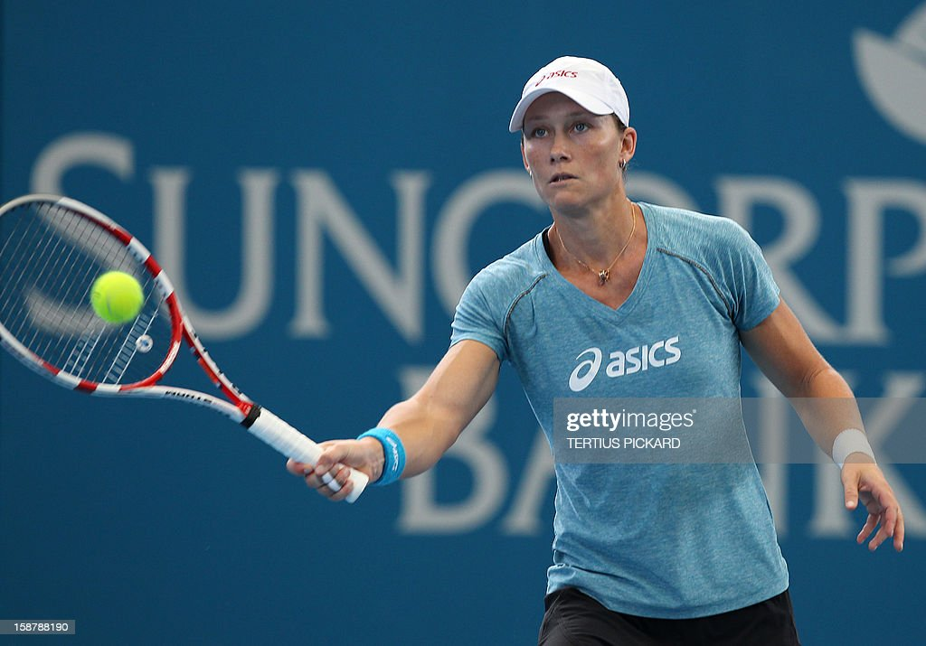 Samantha Stosur of Australia hits the ball during a training session in Brisbane on December 29, 2012, ahead of the upcoming Brisbane International tennis tournament. Top international men's and women's players are using the Brisbane International as a build-up to the Australian Open, which runs from January 14 to 27. AFP PHOTO/Tertius PICKARD USE