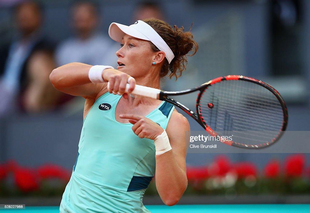 <a gi-track='captionPersonalityLinkClicked' href=/galleries/search?phrase=Samantha+Stosur&family=editorial&specificpeople=194778 ng-click='$event.stopPropagation()'>Samantha Stosur</a> of Australia in action against Carla Suarez Navarro of Spain in their third round match during day five of the Mutua Madrid Open tennis tournament at the Caja Magica on May 04, 2016 in Madrid.