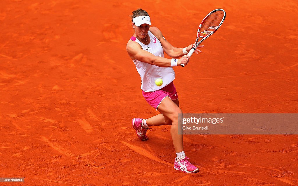 <a gi-track='captionPersonalityLinkClicked' href=/galleries/search?phrase=Samantha+Stosur&family=editorial&specificpeople=194778 ng-click='$event.stopPropagation()'>Samantha Stosur</a> of Australia plays a backhand during her straight sets defeat by Maria Sharapova of Russia in their third round match during day six of the Mutua Madrid Open tennis tournament at the Caja Magica on May 8, 2014 in Madrid, Spain.