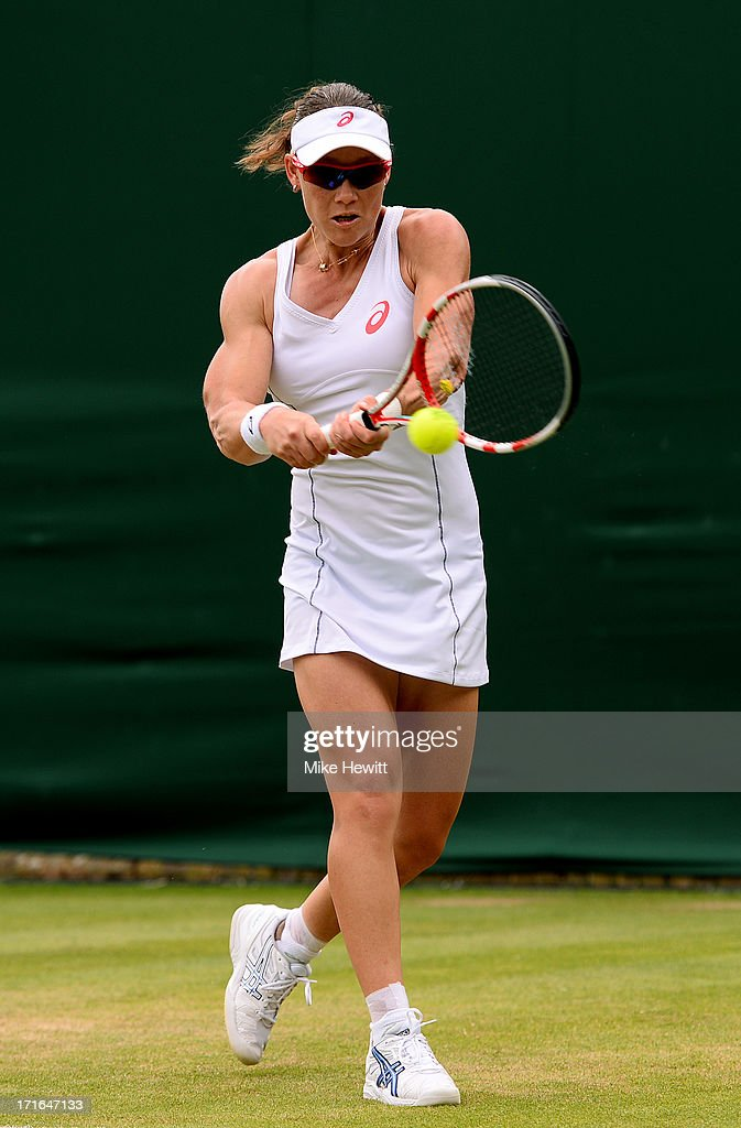 Samantha Stosur of Australia plays a backhand during the Ladies' Singles second round match against Olga Puchkova of Russia on day four of the Wimbledon Lawn Tennis Championships at the All England Lawn Tennis and Croquet Club on June 27, 2013 in London, England.