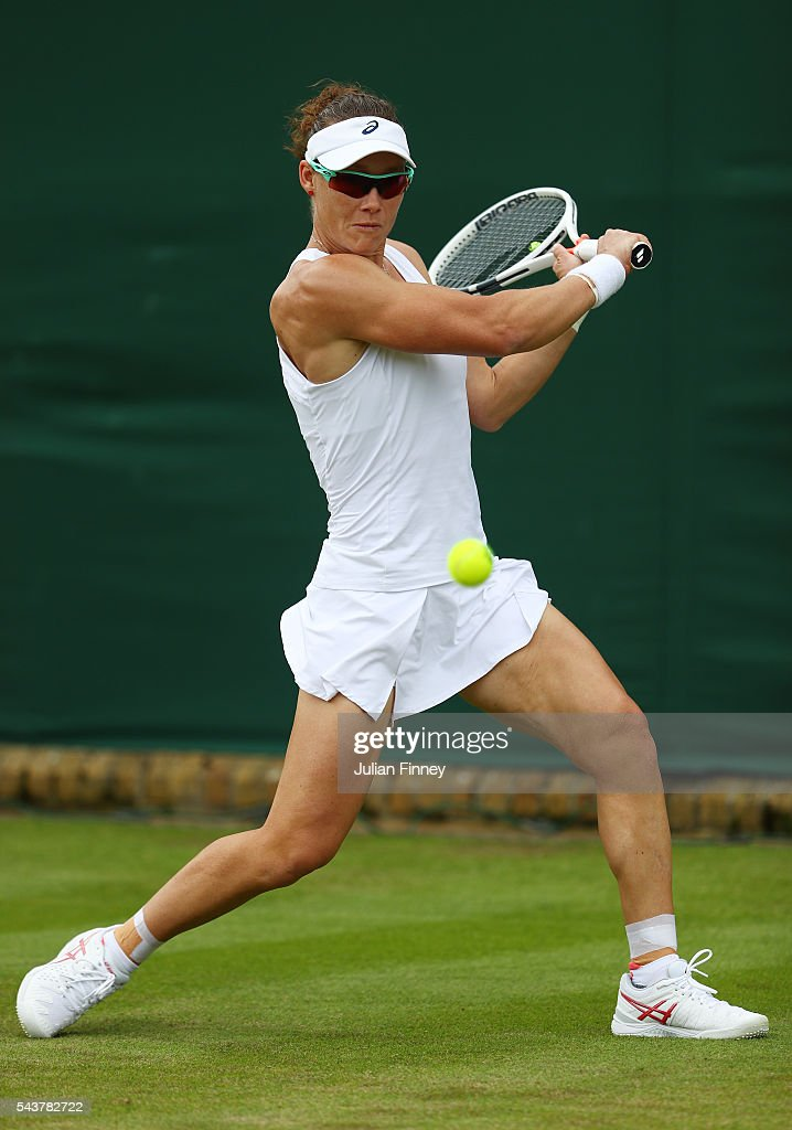 <a gi-track='captionPersonalityLinkClicked' href=/galleries/search?phrase=Samantha+Stosur&family=editorial&specificpeople=194778 ng-click='$event.stopPropagation()'>Samantha Stosur</a> of Australia plays a backhand during the Ladies Singles second round match against Sabine Lisicki of Germany on day four of the Wimbledon Lawn Tennis Championships at the All England Lawn Tennis and Croquet Club on June 30, 2016 in London, England.