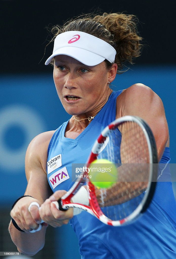 <a gi-track='captionPersonalityLinkClicked' href=/galleries/search?phrase=Samantha+Stosur&family=editorial&specificpeople=194778 ng-click='$event.stopPropagation()'>Samantha Stosur</a> of Australia plays a backhand in her first round match against Jie Zheng of China during day two of the Sydney International at Sydney Olympic Park Tennis Centre on January 7, 2013 in Sydney, Australia.