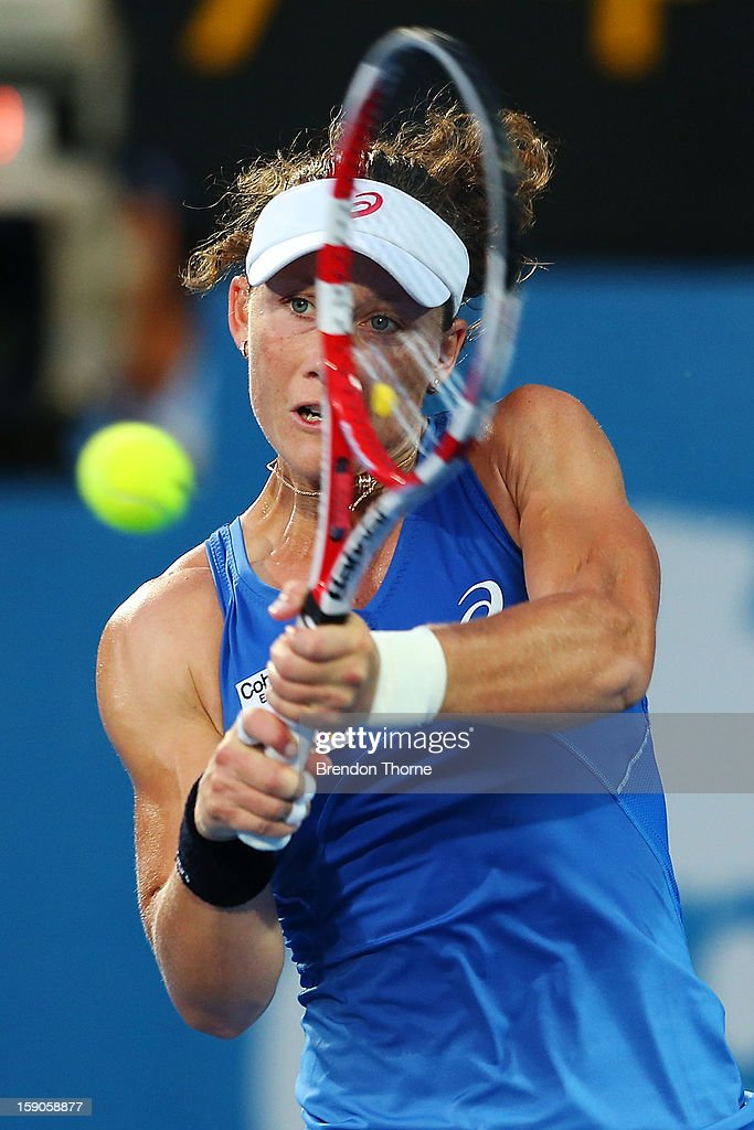 Samantha Stosur of Australia plays a backhand in her first round match against Jie Zheng of China during day two of the Sydney International at Sydney Olympic Park Tennis Centre on January 7, 2013 in Sydney, Australia.