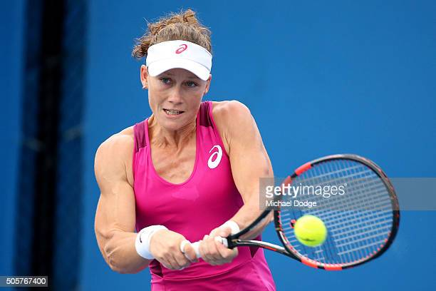 Samantha Stosur of Australia plays a backhand in her first round doubles match with Yaroslava Shvedova of Kazakhstan against Alexandra Dulgheru of...