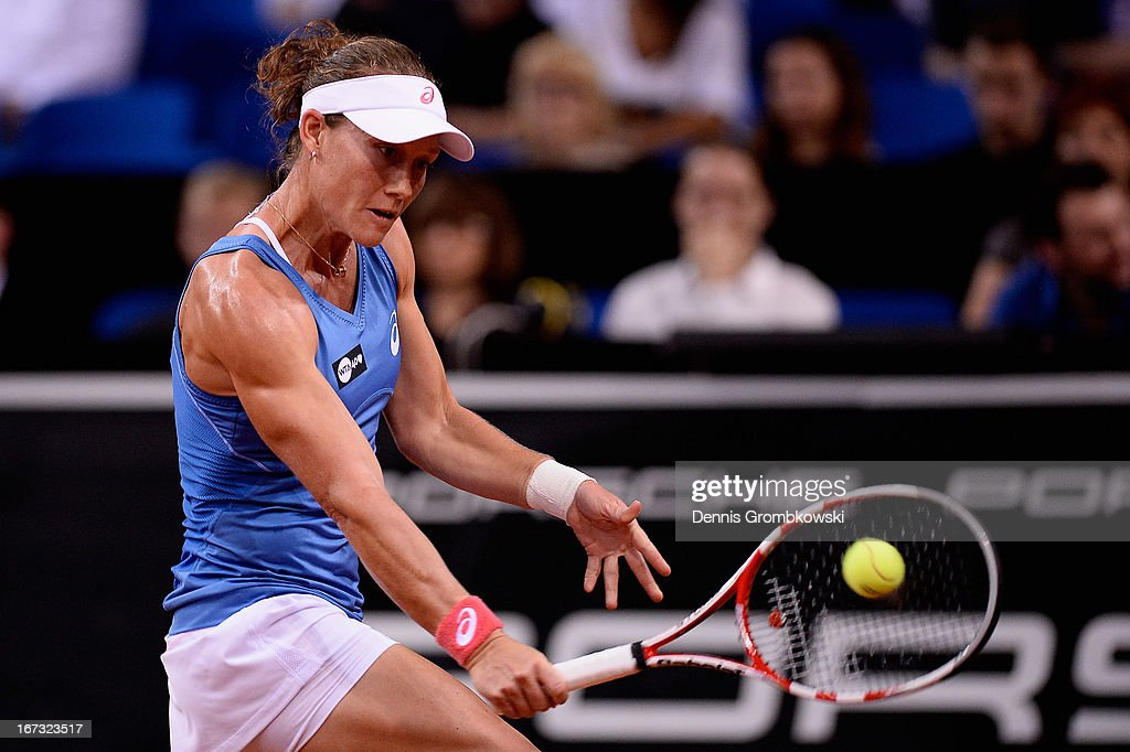 <a gi-track='captionPersonalityLinkClicked' href=/galleries/search?phrase=Samantha+Stosur&family=editorial&specificpeople=194778 ng-click='$event.stopPropagation()'>Samantha Stosur</a> of Australia plays a backhand in her match against Jelena Jankovic of Serbia during Day 3 of the Porsche Tennis Grand Prix at Porsche-Arena on April 24, 2013 in Stuttgart, Germany.