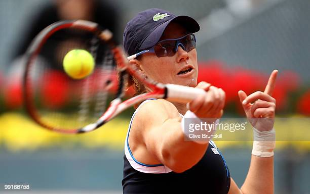 Samantha Stosur of Australia plays a forehand against Patty Schnyder of Switzerland in their third round match during the Mutua Madrilena Madrid Open...
