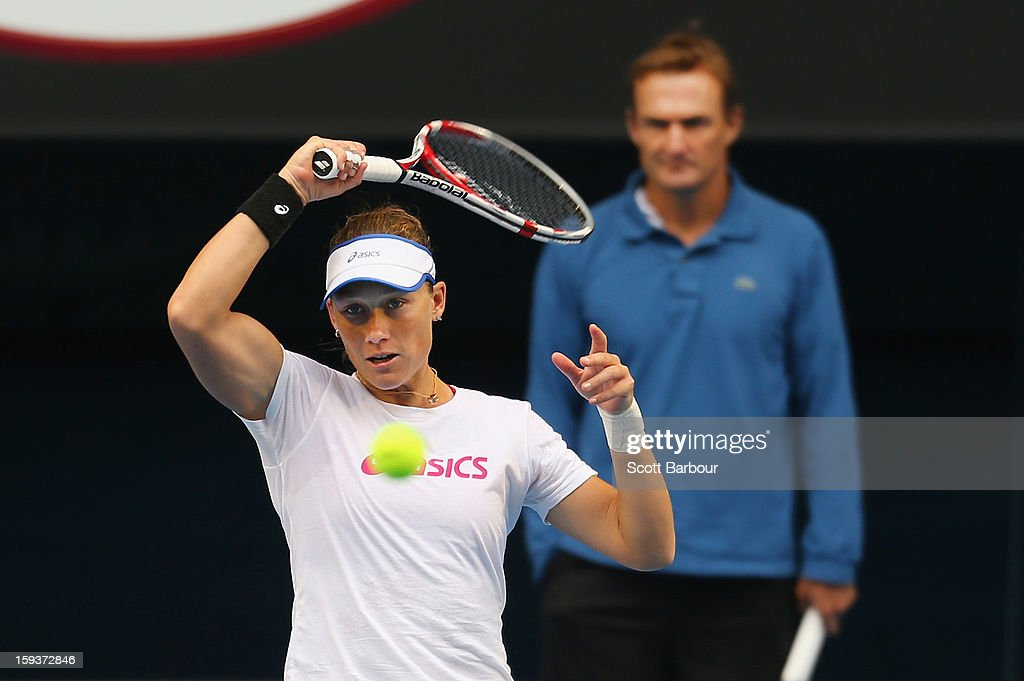 Samantha Stosur of Australia plays a forehand as her coach David Taylor looks on during a practice session ahead of the 2013 Australian Open at Melbourne Park on January 13, 2013 in Melbourne, Australia.