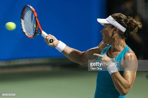 Samantha Stosur of Australia plays a forehand during the match against Jil Teichmann of Switzerland on Day 2 of 2017 Dongfeng Motor Wuhan Open at...