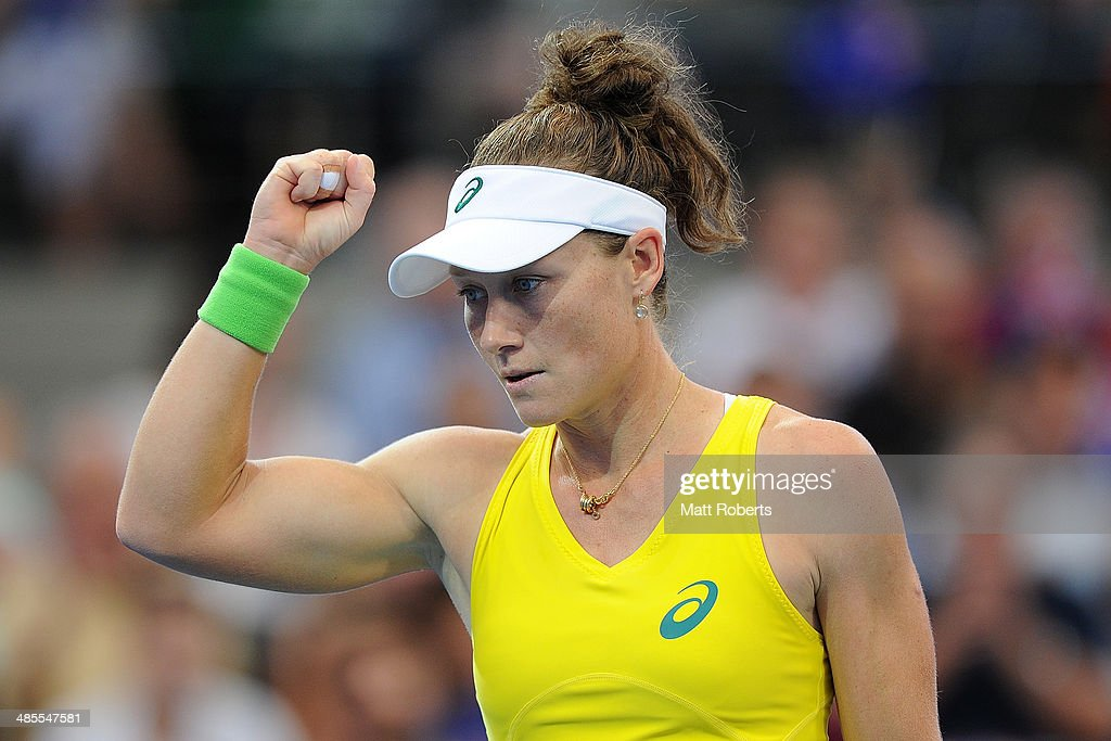 <a gi-track='captionPersonalityLinkClicked' href=/galleries/search?phrase=Samantha+Stosur&family=editorial&specificpeople=194778 ng-click='$event.stopPropagation()'>Samantha Stosur</a> of Australia reacts in her match against Anna Petkovic of Germany during the Fed Cup Semi Final tie between Australia and Germany at Pat Rafter Arena on April 19, 2014 in Brisbane, Australia.