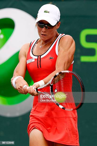Samantha Stosur of Australia returns a shot against Virginie Razzano of France during day six of the 2010 Sony Ericsson Open at Crandon Park Tennis...