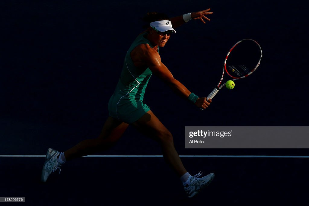<a gi-track='captionPersonalityLinkClicked' href=/galleries/search?phrase=Samantha+Stosur&family=editorial&specificpeople=194778 ng-click='$event.stopPropagation()'>Samantha Stosur</a> of Australia returns a shot to Victoria Duval of United States of America during their women's singles first round match on Day Two of the 2013 US Open at USTA Billie Jean King National Tennis Center on August 27, 2013 in the Flushing neighborhood of the Queens borough of New York City.