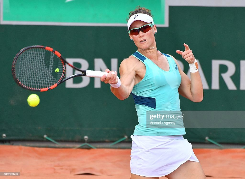 Samantha Stosur (C) of Australia returns the ball during women's single second round match against Shuai Zhang of China at the French Open tennis tournament at Roland Garros in Paris, France on May 25, 2016.