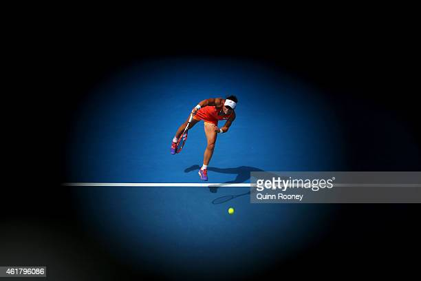 Samantha Stosur of Australia serves in her first round match against Monica Niculescu of Romania during day two of the 2015 Australian Open at...