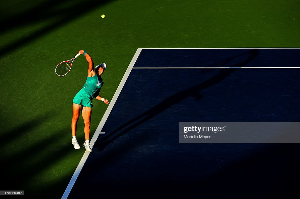 <a gi-track='captionPersonalityLinkClicked' href=/galleries/search?phrase=Samantha+Stosur&family=editorial&specificpeople=194778 ng-click='$event.stopPropagation()'>Samantha Stosur</a> of Australia serves to Victoria Duval of United States of America during their women's singles first round match on Day Two of the 2013 US Open at USTA Billie Jean King National Tennis Center on August 27, 2013 in the Flushing neighborhood of the Queens borough of New York City.