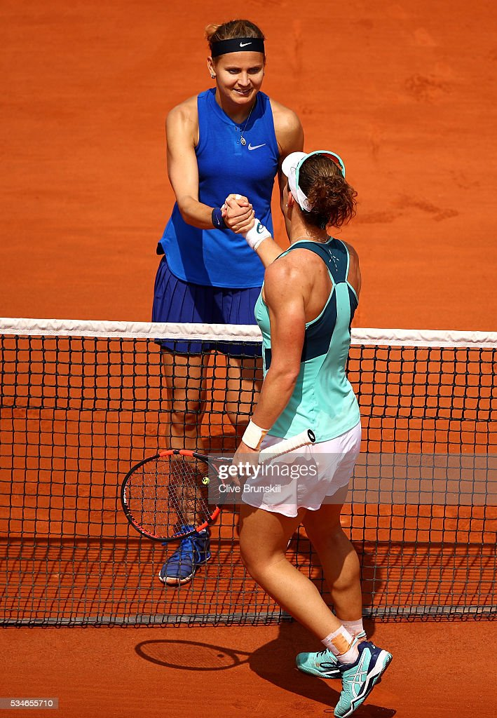 <a gi-track='captionPersonalityLinkClicked' href=/galleries/search?phrase=Samantha+Stosur&family=editorial&specificpeople=194778 ng-click='$event.stopPropagation()'>Samantha Stosur</a> of Australia (r) shakes hands with Lucie Safarova of Czech Republic following victory during the Ladies Singles third round match on day six of the 2016 French Open at Roland Garros on May 27, 2016 in Paris, France.