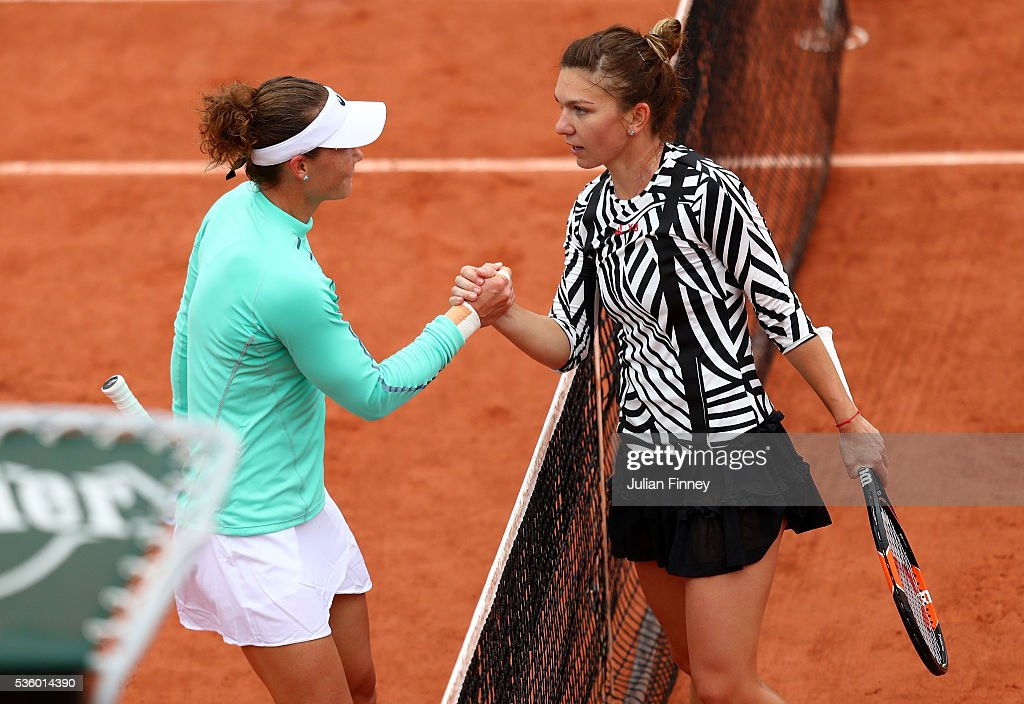 <a gi-track='captionPersonalityLinkClicked' href=/galleries/search?phrase=Samantha+Stosur&family=editorial&specificpeople=194778 ng-click='$event.stopPropagation()'>Samantha Stosur</a> of Australia shakes hands with <a gi-track='captionPersonalityLinkClicked' href=/galleries/search?phrase=Simona+Halep&family=editorial&specificpeople=4835837 ng-click='$event.stopPropagation()'>Simona Halep</a> of Romania following her victory during the Ladies Singles fourth round match on day ten of the 2016 French Open at Roland Garros on May 31, 2016 in Paris, France.