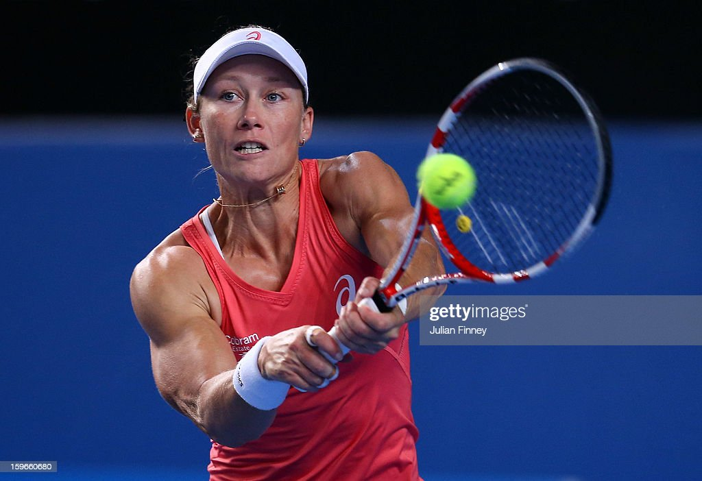 Samantha Stosur plays a backhand in her mixed doubles match partnered with Luke Saville of Australia against Sania Mirza of India and Bob Bryan of USA during day five of the 2013 Australian Open at Melbourne Park on January 18, 2013 in Melbourne, Australia.