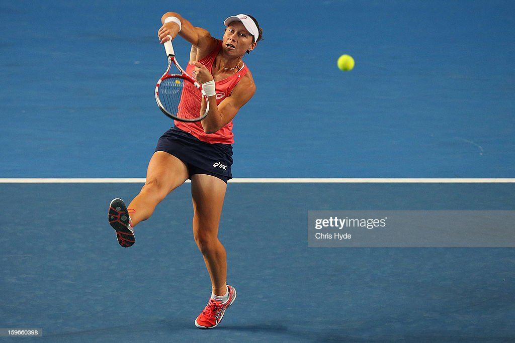 Samantha Stosur plays a smash in her mixed doubles match partnered with Luke Saville of Australia against Sania Mirza of India and Bob Bryan of USA during day five of the 2013 Australian Open at Melbourne Park on January 18, 2013 in Melbourne, Australia.