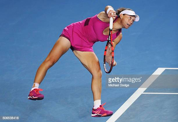 Samantha Stosur serves with John Peers of Australia play in their Round 1 mixed doubles match against Arina Rodionova and Matt Reid of Australia...