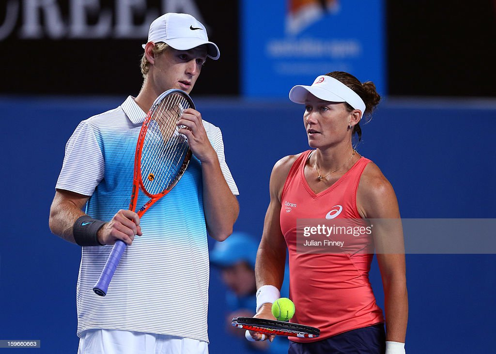 Samantha Stosur talks tactics in her mixed doubles match partnered with Luke Saville of Australia against Sania Mirza of India and Bob Bryan of USA during day five of the 2013 Australian Open at Melbourne Park on January 18, 2013 in Melbourne, Australia.