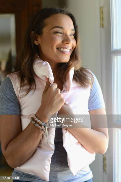 Samantha Tanner gets cozy in a Lizzie Stanton vest wearing Love Thirteen bracelets at A Day of IMPRESSIONS with Brands and Influencers at the Artists...