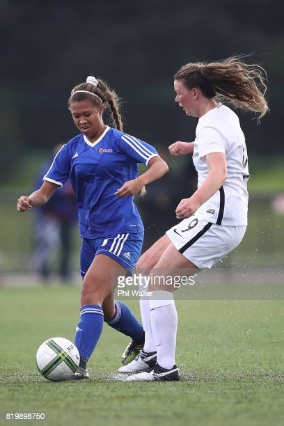 Samantha Tawharu of New Zealand is tackled by Rachael Tagatauli of Samoa during the Oceania U19 Womens Championship match between New Zealand and...