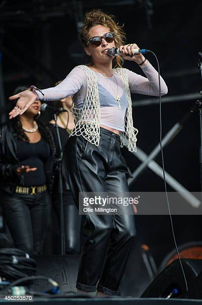 Samantha Urbani of Friends performs onstage with Blood Orange on stage at Field Day Festival at Victoria Park on June 7 2014 in London United Kingdom