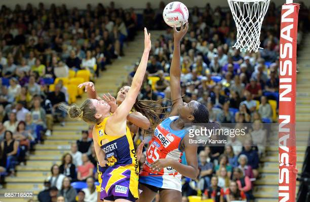 Samantha Wallace of the Swifts competes for the ball against Geva Mentor and Karla Mostert of the Lightning during the round 13 Super Netball match...