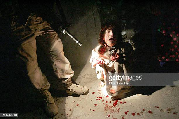 Samar Hassan screams after her parents were killed by US Soldiers with the 25th Infantry Division in a shooting January 18 2005 in Tal Afar Iraq The...