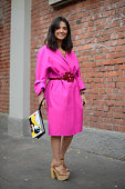 Samar Seraqui de Buttafoco poses wearing a Rochas dress Tod's belt Chanel bag and top shop shoes on September 18 2014 in Milan Italy