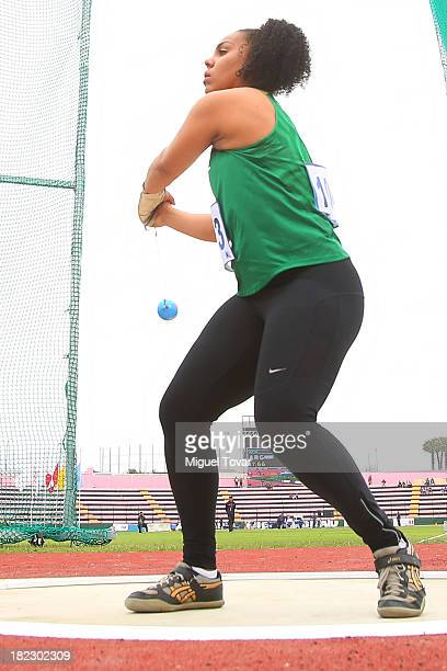 Samara Furtado of Brazil competes during Women's hammer throw final event as part of the I ODESUR South American Youth Games at Estadio Miguel Grau...